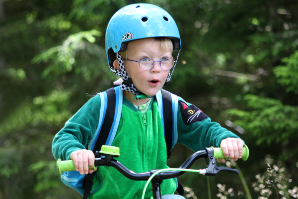 Kid with blue helmet and green bell on his handle bar