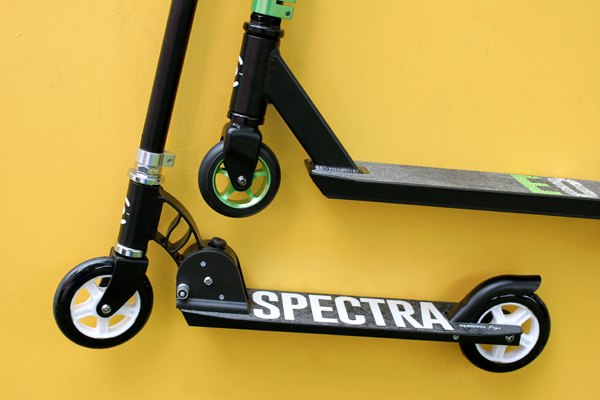 Scooters, one with green details and one with white details