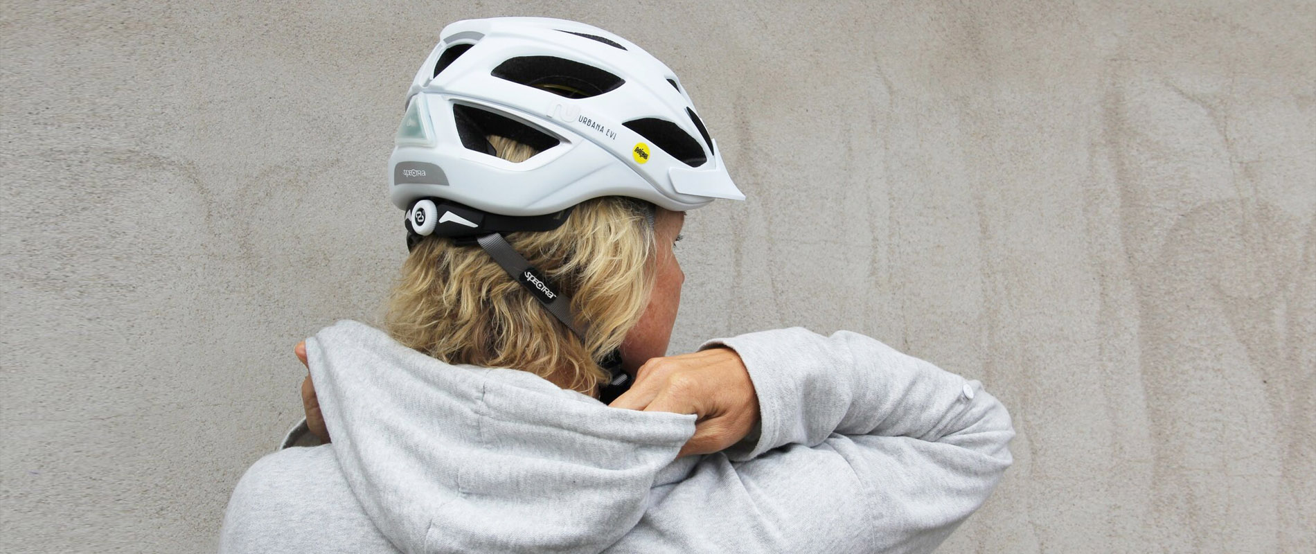 Commute rider with white spectra helmet